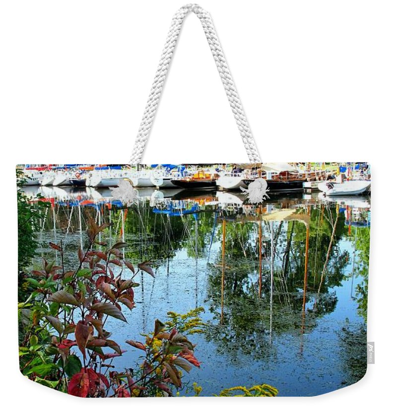 Flowers Weekender Tote Bag featuring the photograph Reflections In The Pool by Ian MacDonald