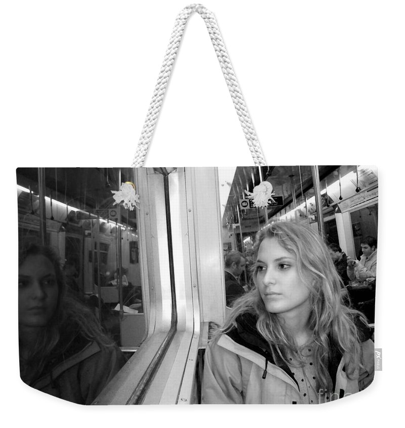 London Weekender Tote Bag featuring the photograph Reflections On A London Train by Madeline Ellis