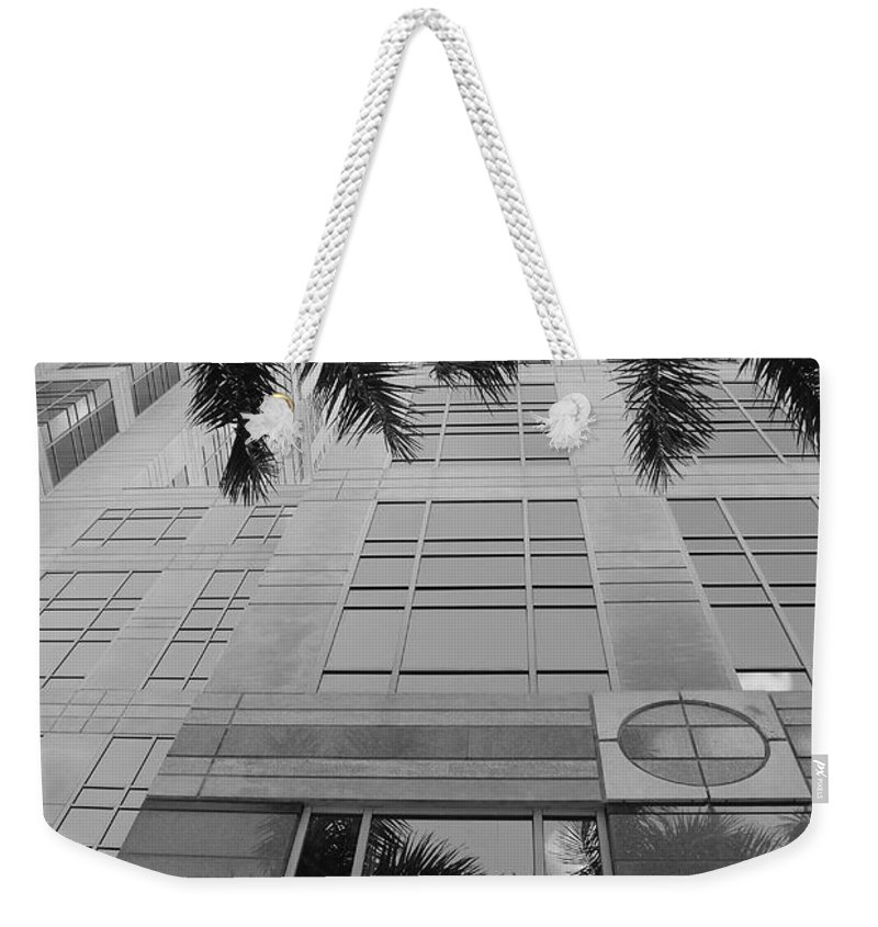 Architecture Weekender Tote Bag featuring the photograph Reflections On The Building by Rob Hans