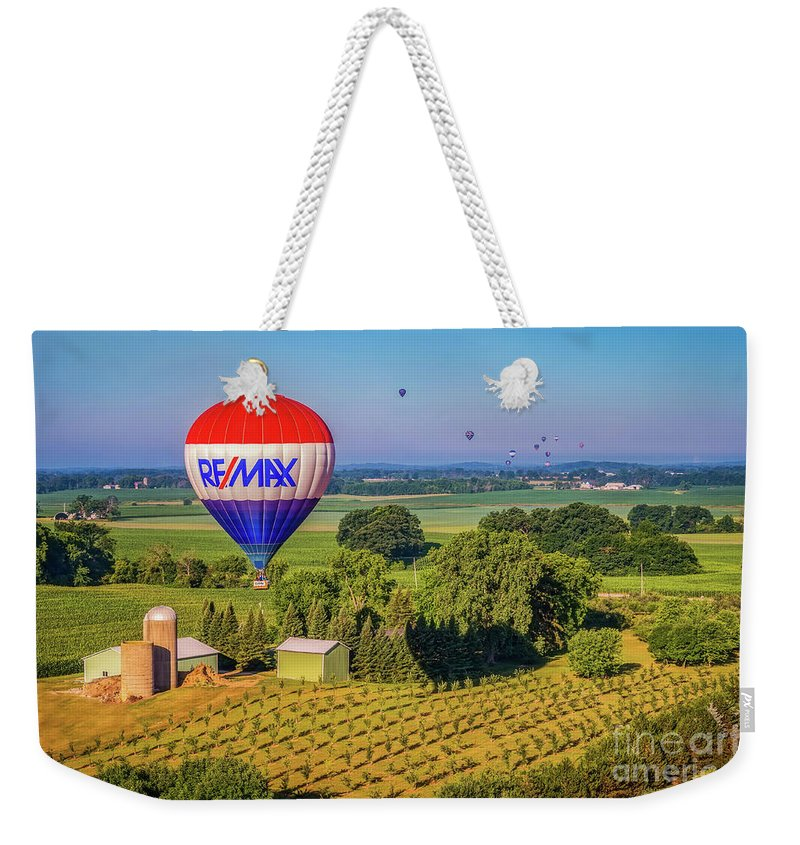 Hot Air Balloon Weekender Tote Bag featuring the photograph Remax Hot Air Balloon Ride by Monica Hall