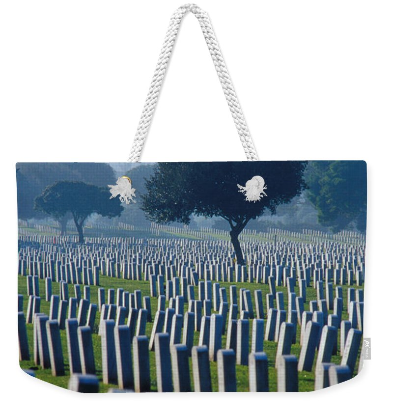 National Cemetery Weekender Tote Bag featuring the photograph Remembering Walt Bem by Jerry McElroy