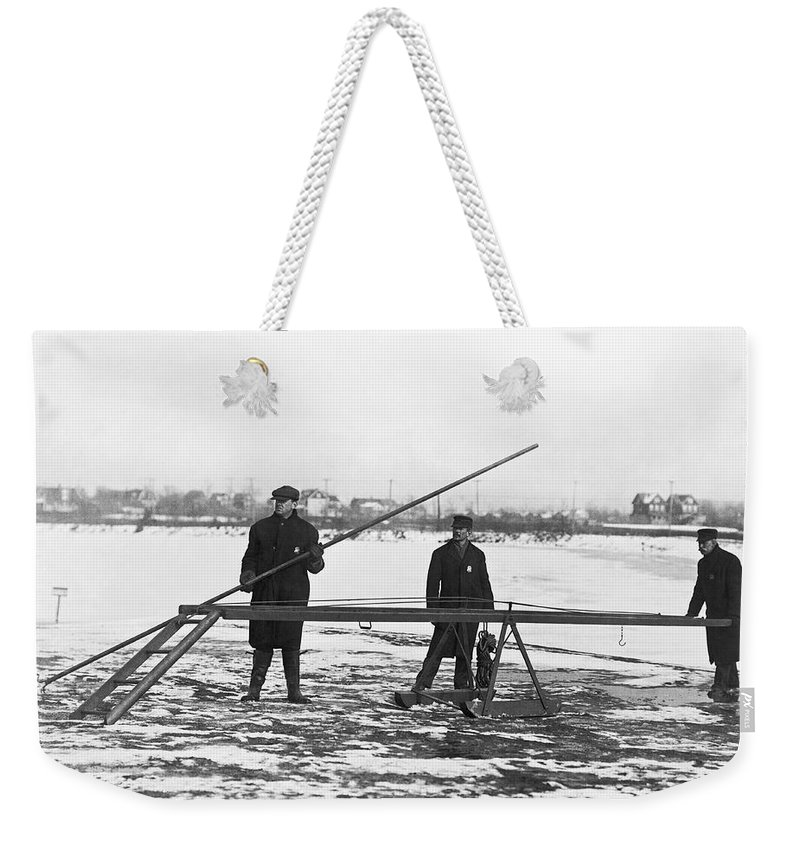 1910s Weekender Tote Bag featuring the photograph Rescue For Skating On Thin Ice by Underwood Archives