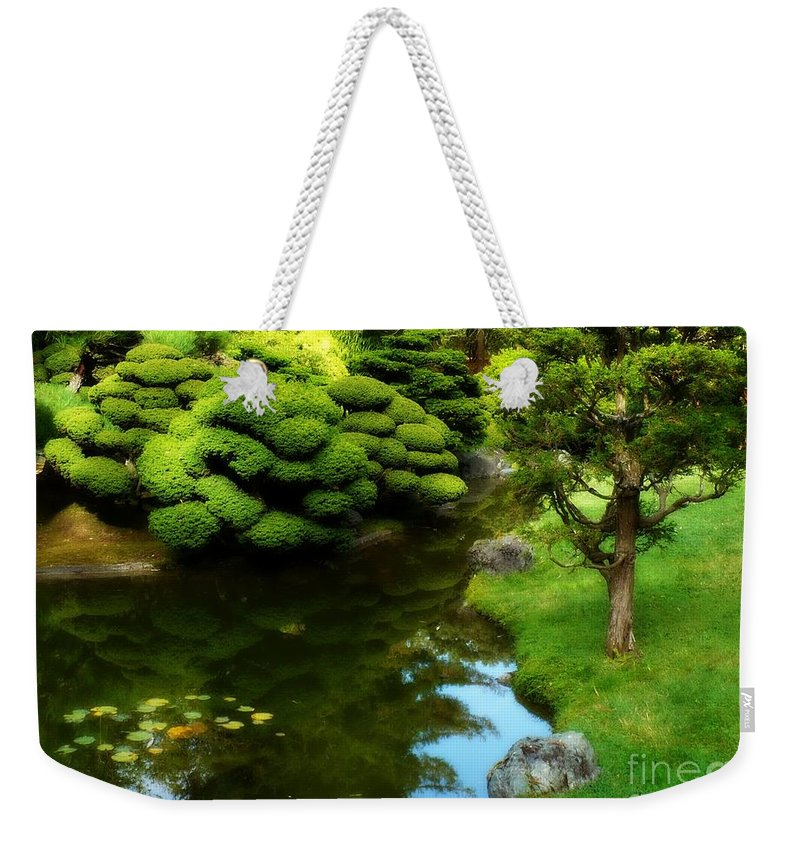 Peaceful Garden Weekender Tote Bag featuring the photograph Rest By The Pond by Carol Groenen