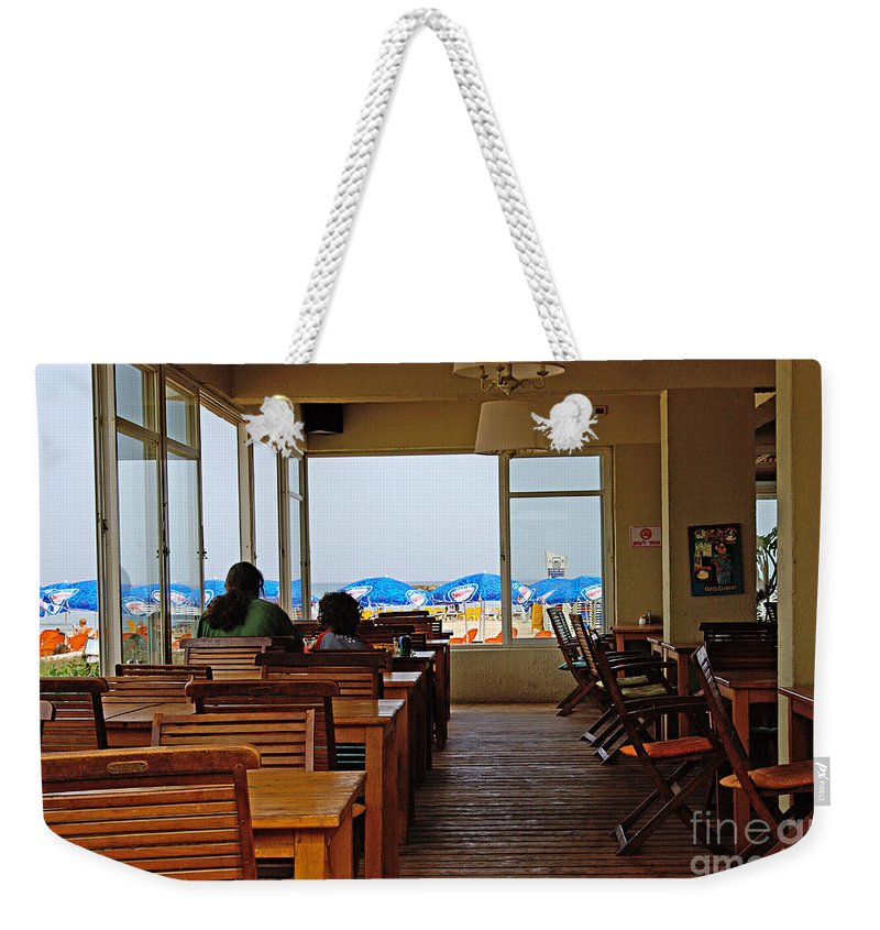 Beach Weekender Tote Bag featuring the photograph Restaurant On A Beach In Tel Aviv Israel by Zal Latzkovich