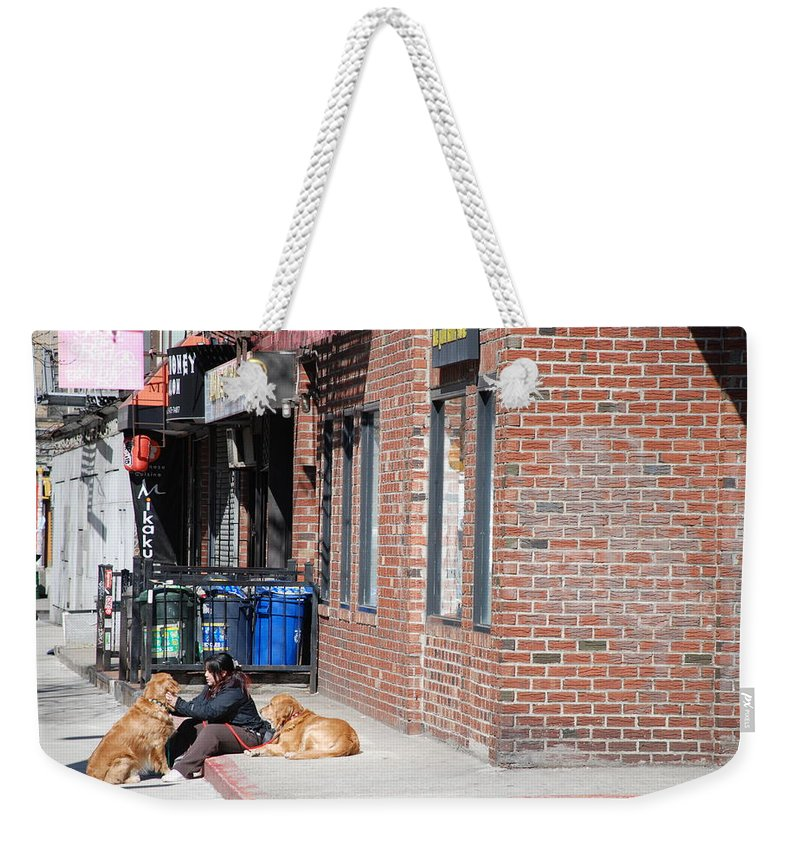 Girl Weekender Tote Bag featuring the photograph Resting On The Corner by Rob Hans
