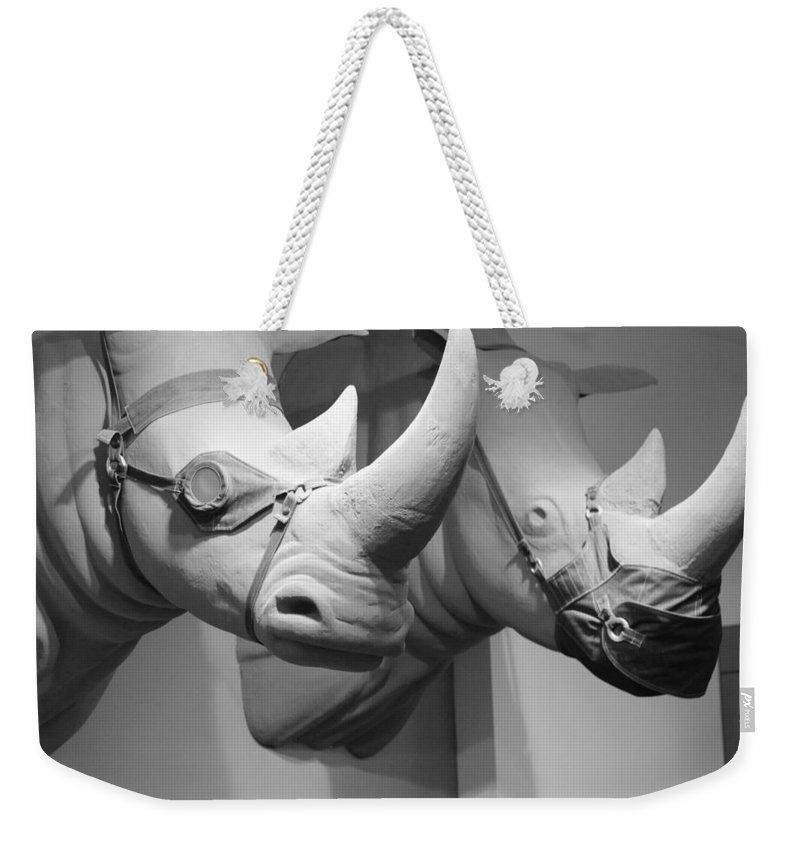 Macro Weekender Tote Bag featuring the photograph Rhinos In Black And White by Rob Hans