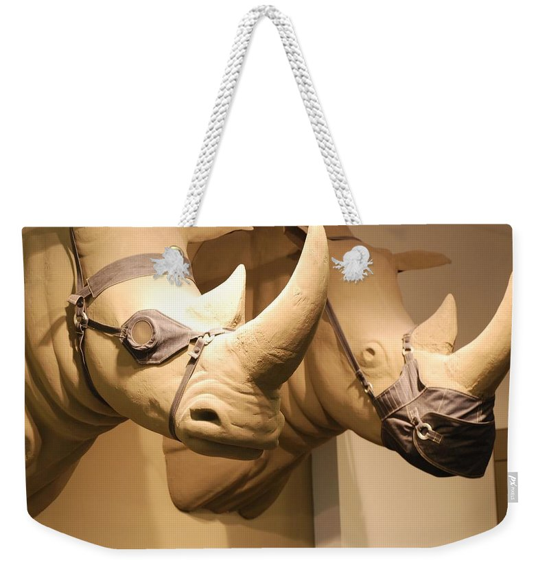 Macro Weekender Tote Bag featuring the photograph Rhinos by Rob Hans