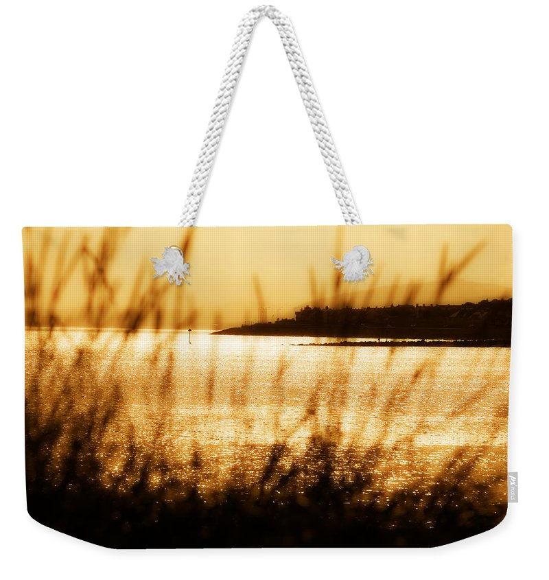 Rhos Weekender Tote Bag featuring the photograph Rhos Point Viewed Through Beach Grass by Mal Bray