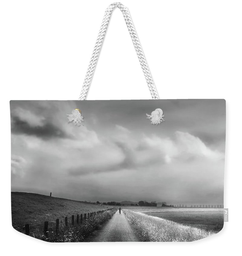 Cyclist Weekender Tote Bag featuring the photograph Ride The Moonlight by Wim Lanclus