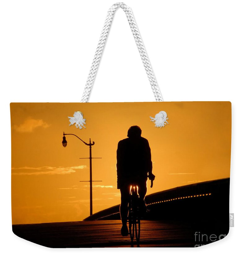 Bicycle Weekender Tote Bag featuring the photograph Riding At Sunset by David Lee Thompson