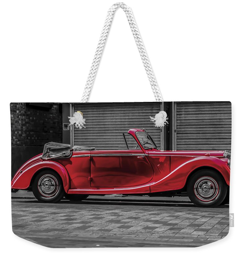 Riley Rmd Drophead Coupe Weekender Tote Bag featuring the photograph Riley Rmd 1950 Drophead Coupe by Claire Doherty