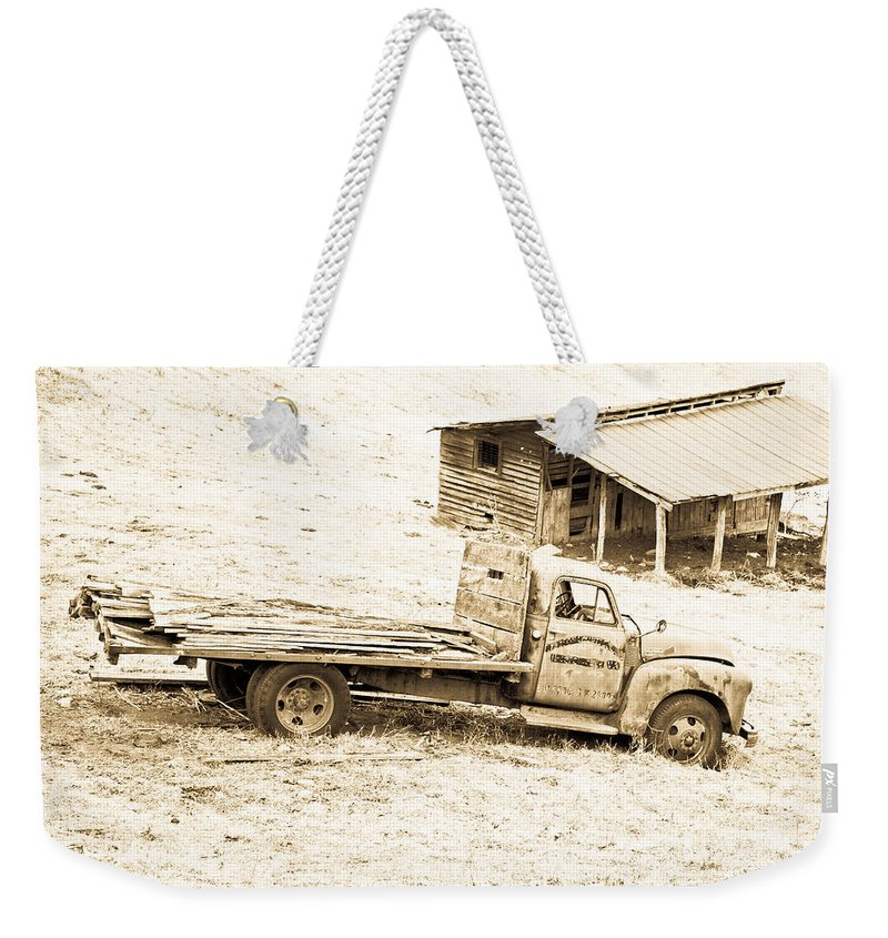 Truck Weekender Tote Bag featuring the photograph Rip Old Truck In Field by John Harmon