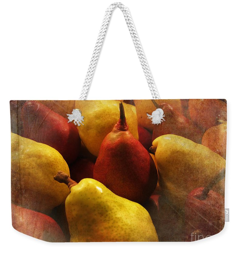 Ripe Pears And Two Persimmons Weekender Tote Bag featuring the photograph Ripe Pears And Two Persimmons by Victoria Harrington