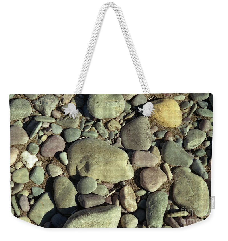 River Rock Weekender Tote Bag featuring the photograph River Rock by Richard Rizzo