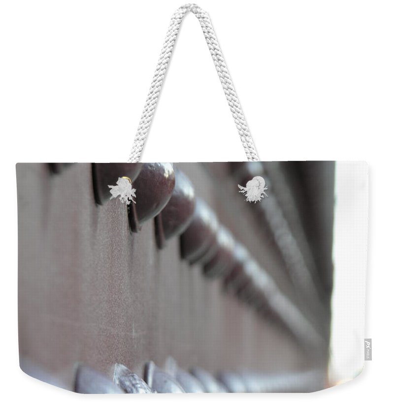 Rivets Weekender Tote Bag featuring the photograph Rivets by Diane Greco-Lesser