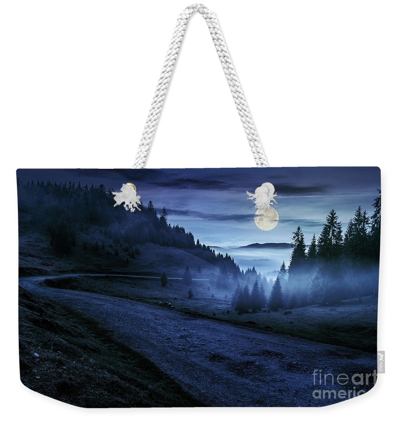 Road Weekender Tote Bag featuring the photograph Road Near Foggy Forest In Mountains At Night by Michael Pelin