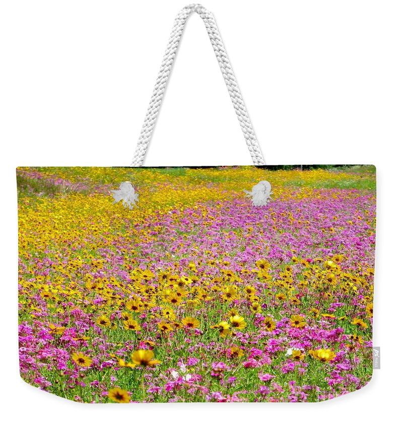 Roadside Weekender Tote Bag featuring the pyrography Roadside Flower Garden by Tim Townsend