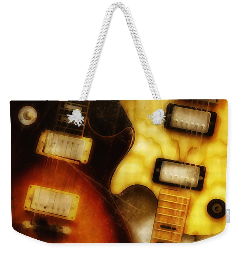 Les Paul Weekender Tote Bag featuring the photograph Rock And Roll Never Forgets by Bill Cannon