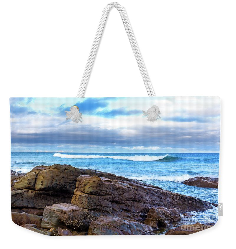 Ocean Weekender Tote Bag featuring the photograph Rock And Wave by Perry Webster