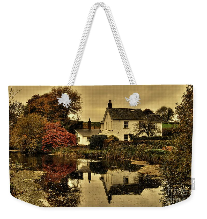 Rock Weekender Tote Bag featuring the photograph Rock Cottage by Rob Hawkins