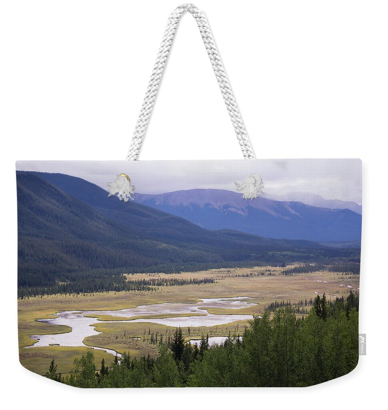 Nature Weekender Tote Bag featuring the photograph Rock Lake by Christian Horisberger