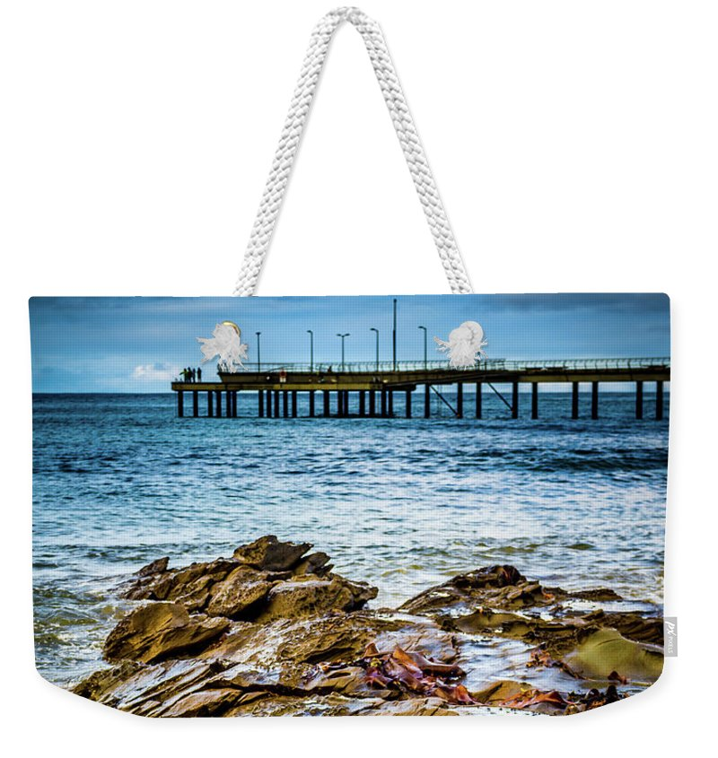 Rocks Weekender Tote Bag featuring the photograph Rock Pier by Perry Webster