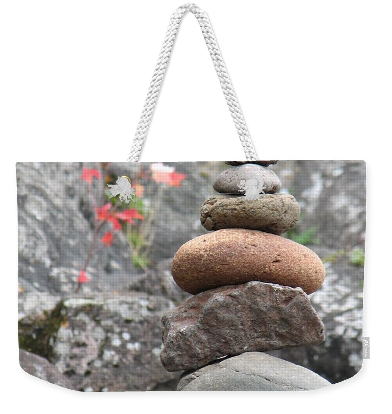 Rocks Weekender Tote Bag featuring the photograph Rocks And Roses by Kelly Mezzapelle