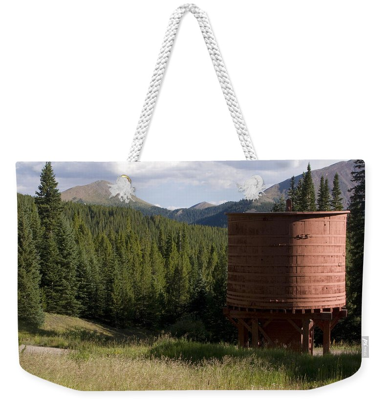 Landscape Weekender Tote Bag featuring the photograph Rocky Mountain Water Tower by Jeffery Ball