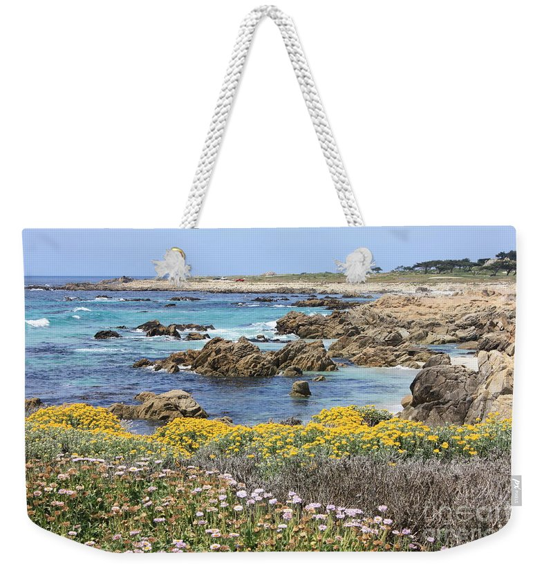 Ocean Weekender Tote Bag featuring the photograph Rocky Surf With Wildflowers by Carol Groenen