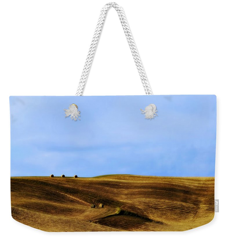 Landscape Weekender Tote Bag featuring the photograph Rolling Hills And Bales Of Hay by Marilyn Hunt