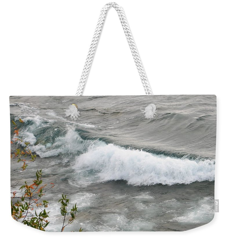 Wave Weekender Tote Bag featuring the photograph Rolling by Kelly Mezzapelle