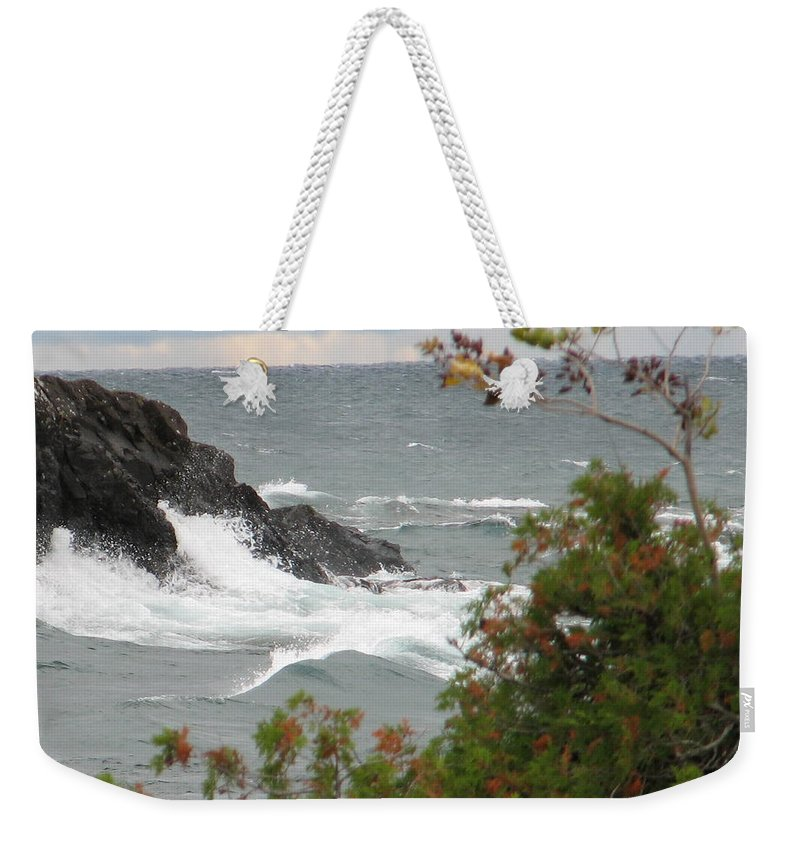 Waves Weekender Tote Bag featuring the photograph Rolling Storm by Kelly Mezzapelle