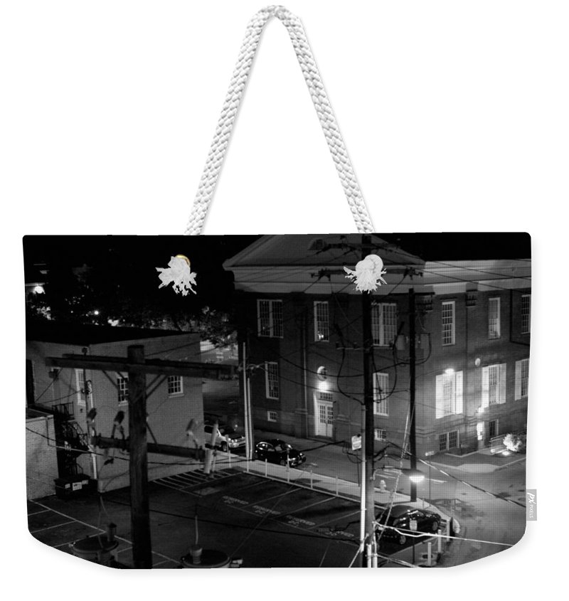 Black White Weekender Tote Bag featuring the photograph Rooftop Court by Jean Macaluso
