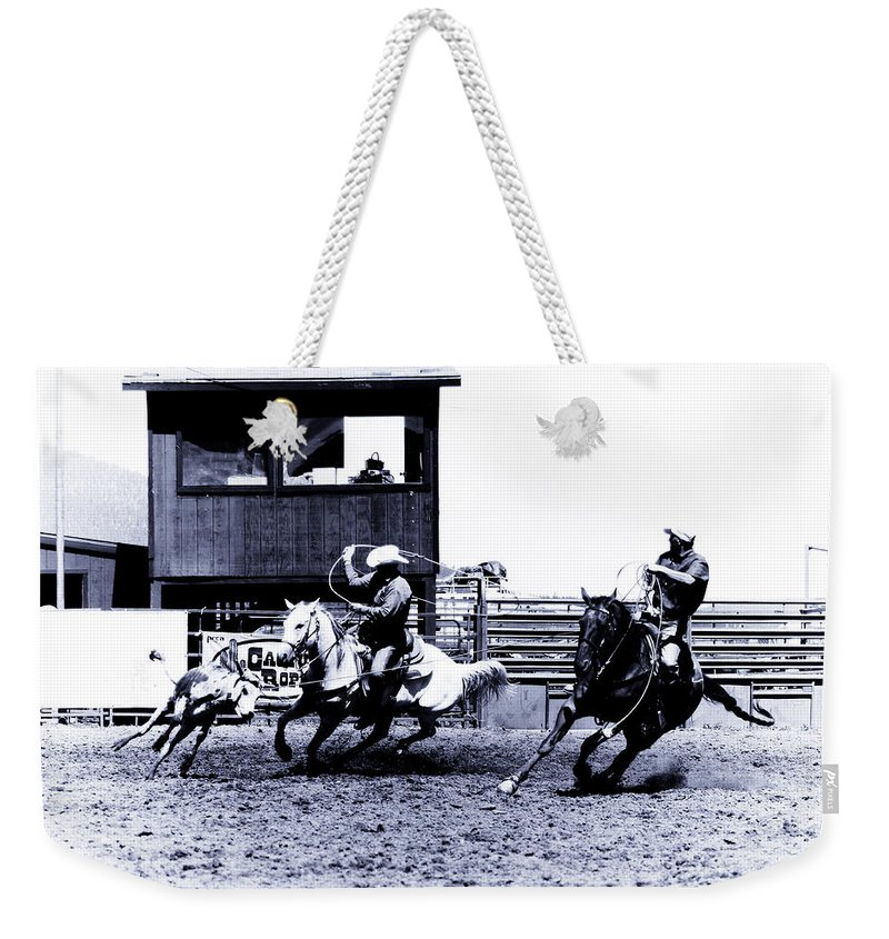 Rodeo Weekender Tote Bag featuring the photograph Roping 1 by Scott Sawyer