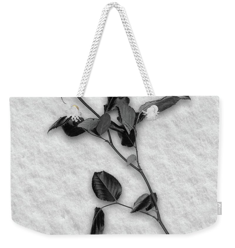 Red Weekender Tote Bag featuring the photograph Rose In Snow by Wim Lanclus