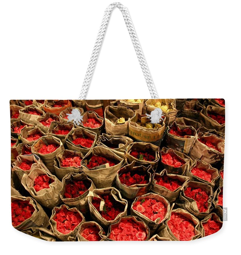 Roses Weekender Tote Bag featuring the photograph Rose Rolled In Newspaper by Minaz Jantz