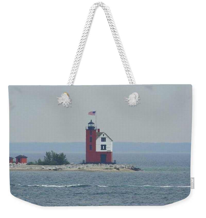 Old Weekender Tote Bag featuring the photograph Round Island Lighthouse On A Foggy Day by Anita Hiltz