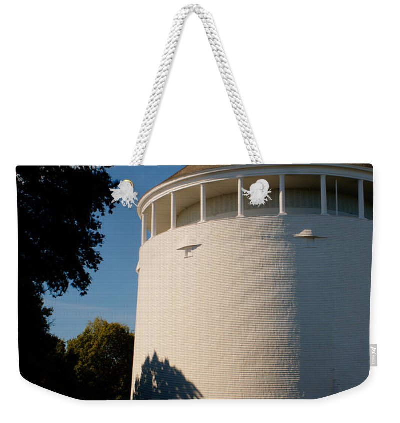 Water Weekender Tote Bag featuring the photograph Round Water Tank In The Sun by Douglas Barnett