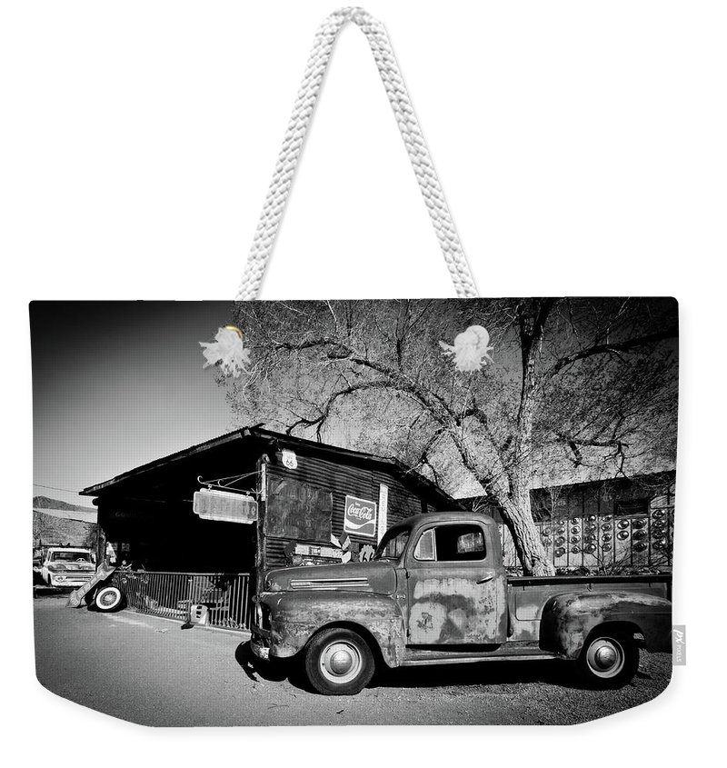 Notice Weekender Tote Bag featuring the photograph Route 66-58 by Avril Christophe