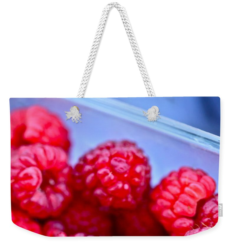 Red Weekender Tote Bag featuring the photograph Ruby Raspberries by Nadine Rippelmeyer