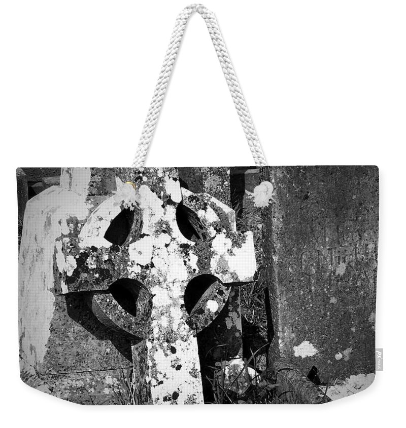 Celtic Weekender Tote Bag featuring the photograph Rugged Cross At Fuerty Cemetery Roscommon Ireland by Teresa Mucha