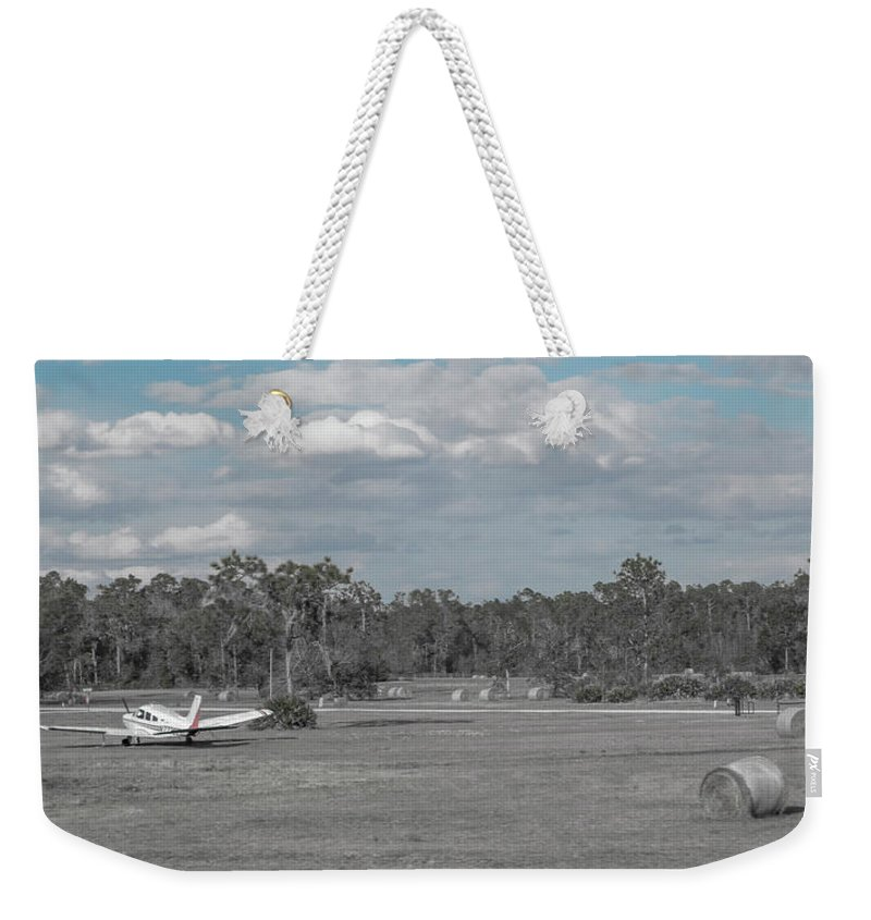 Airplane Weekender Tote Bag featuring the photograph Rural Parking by Betsy Knapp
