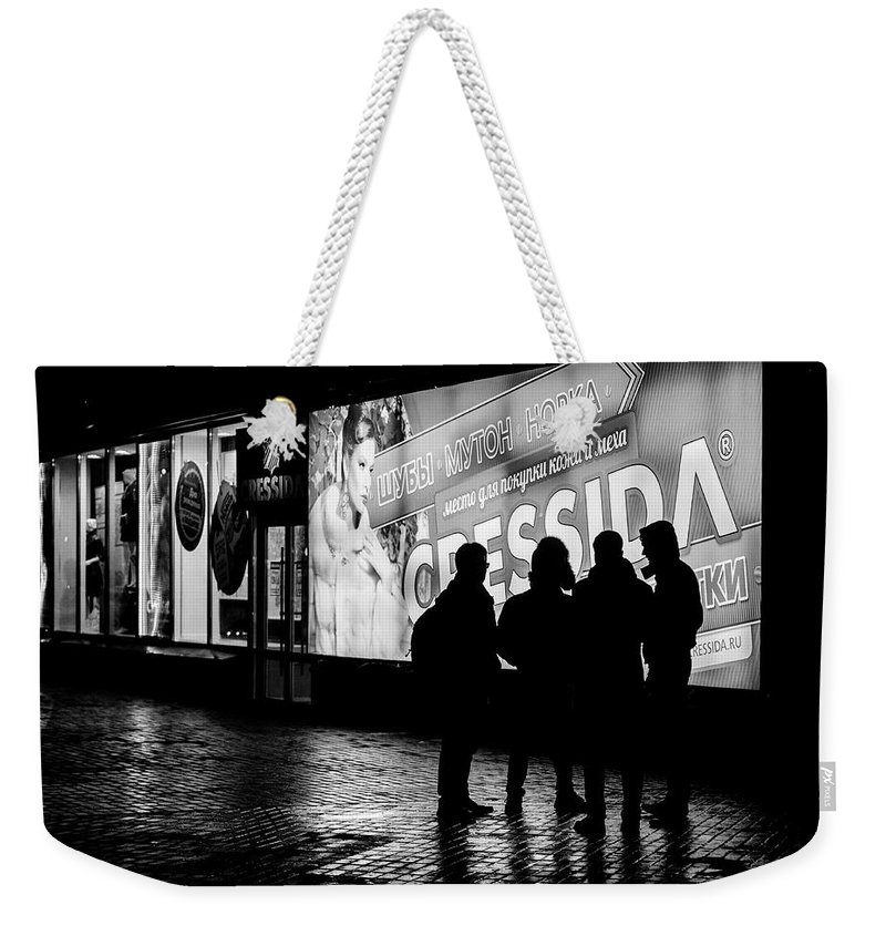Online Gallery Weekender Tote Bag featuring the photograph Russian Teens At Night Outside A Shopping Center by John Williams