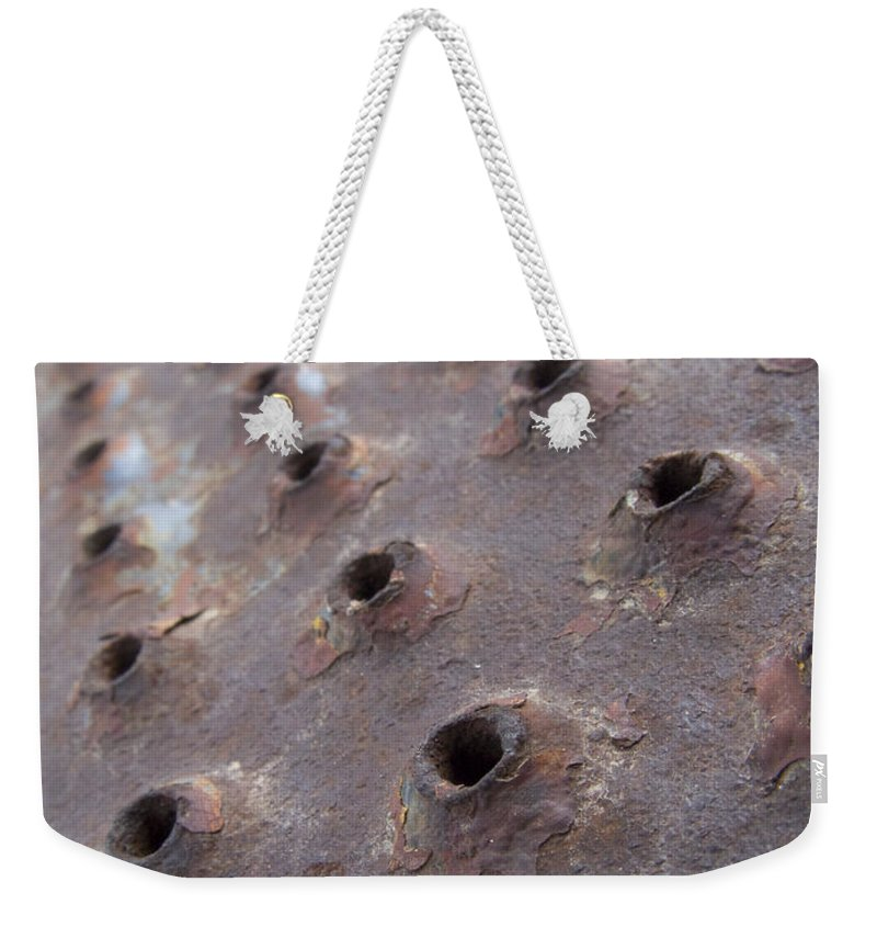 Rust Weekender Tote Bag featuring the photograph Rusted Pattern by Jeffery Ball