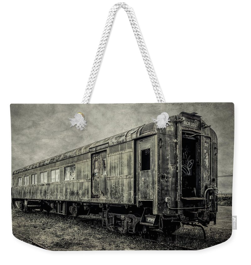 Railroad Weekender Tote Bag featuring the photograph Rusting Passenger Car Ft Bragg by Garry Gay