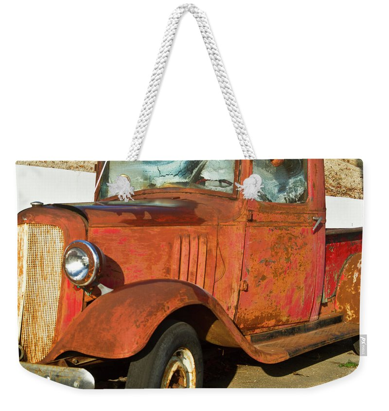 Rusty Weekender Tote Bag featuring the photograph Rusty Chevrolet Pickup Truck 1934 by Douglas Barnett