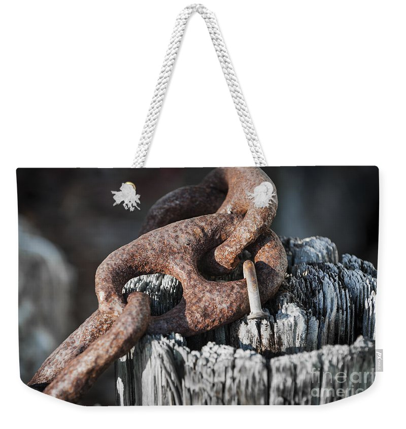Metal Weekender Tote Bag featuring the photograph Rusty Iron Chain Railing Fragment by Elena Elisseeva