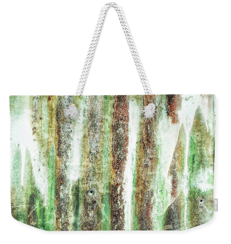 Abstract Weekender Tote Bag featuring the photograph Rusty Metal Background by Tom Gowanlock