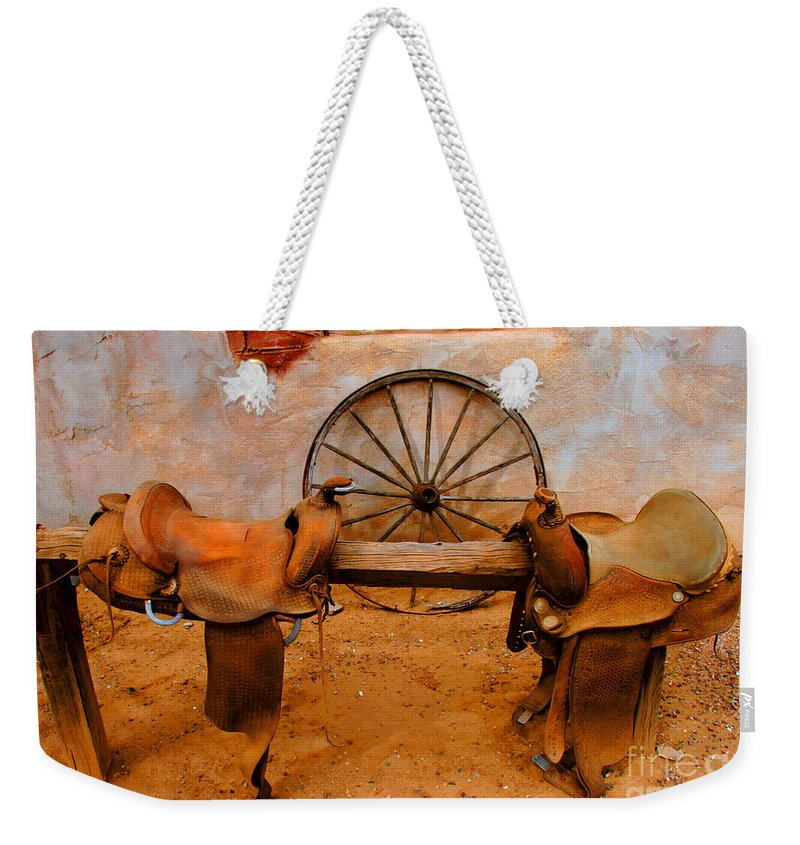Canyon Creek Ranch Weekender Tote Bag featuring the photograph Saddle Town by Tap On Photo