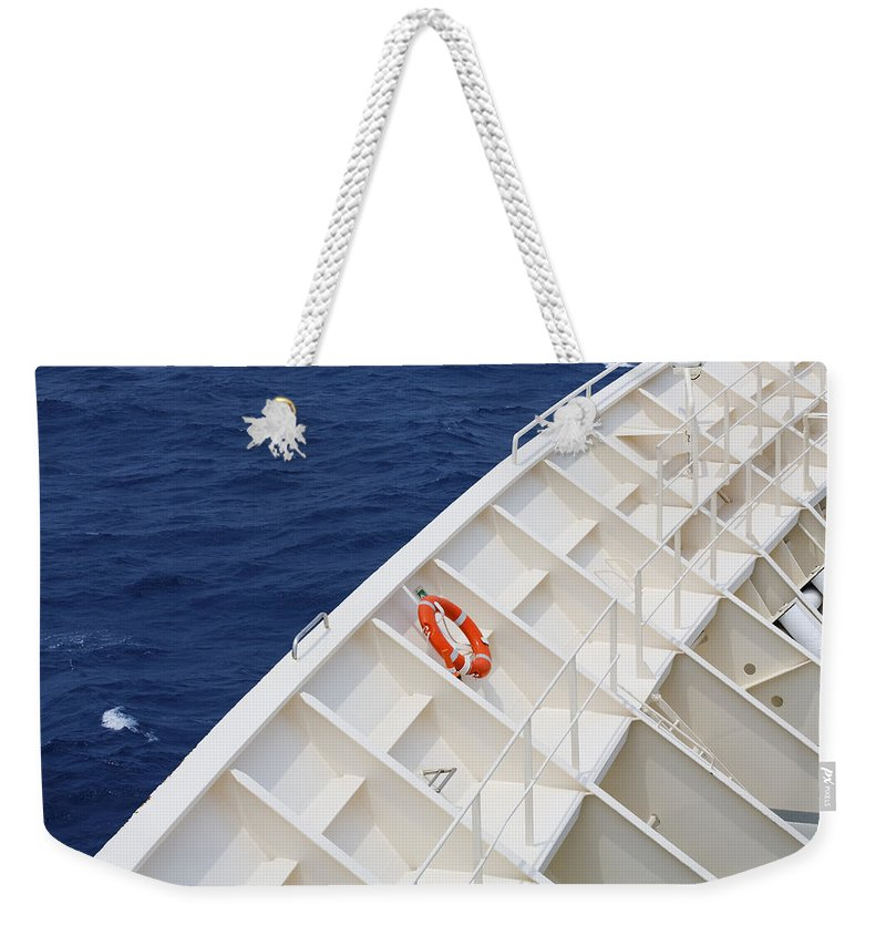 Life Belt Weekender Tote Bag featuring the photograph Safety At Sea by Diane Macdonald